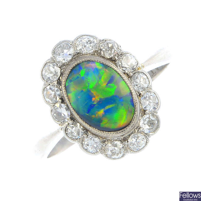 An early 20th century opal and diamond cluster ring.