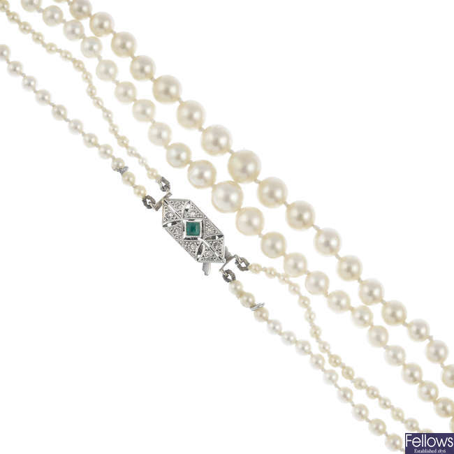 A natural pearl two-row necklace, with emerald and diamond clasp.