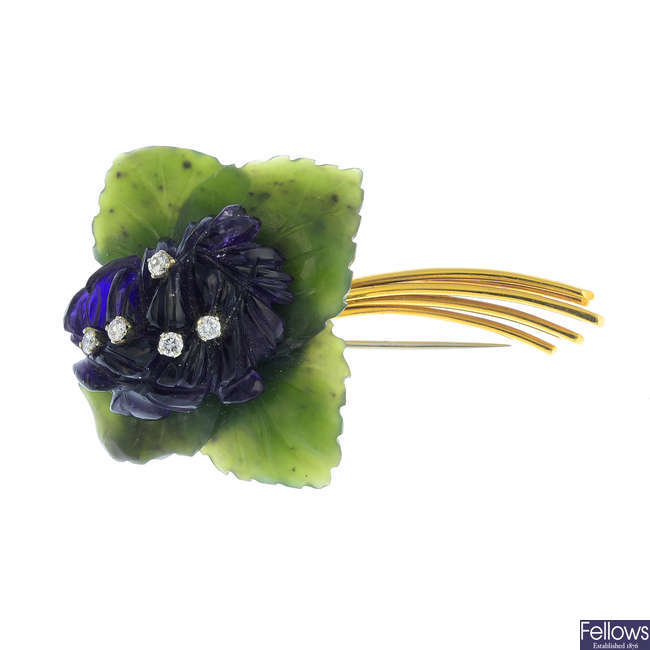 A diamond and gem-set floral brooch.