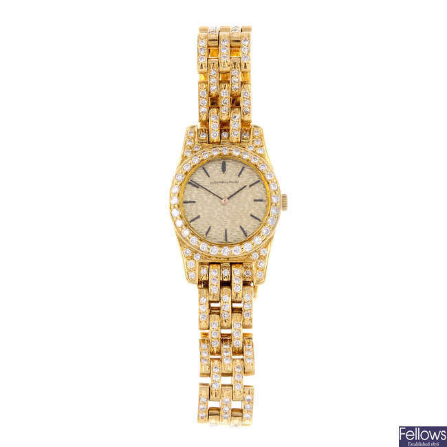 AUDEMARS PIGUET - a lady's 18ct yellow gold bracelet watch.