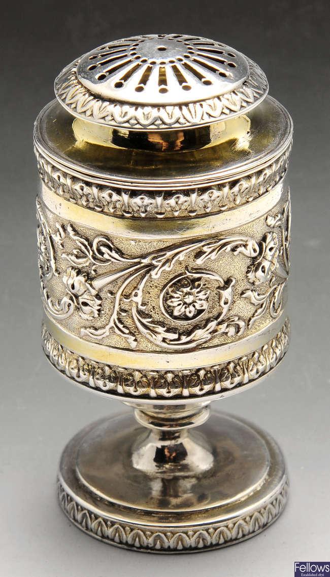 A George III silver pounce pot.