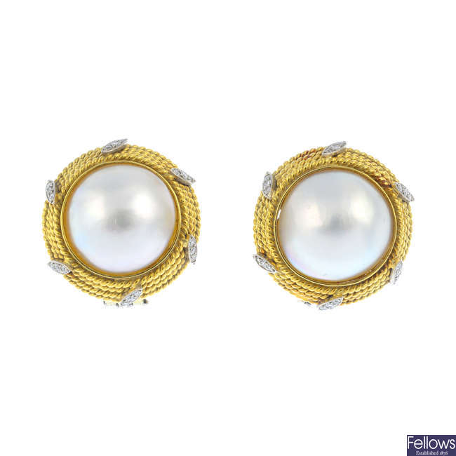 A pair of mabe pearl and diamond earrings.