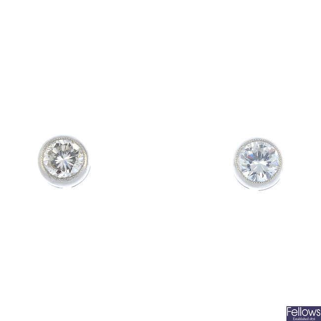 A pair of platinum brilliant-cut diamond stud earrings.