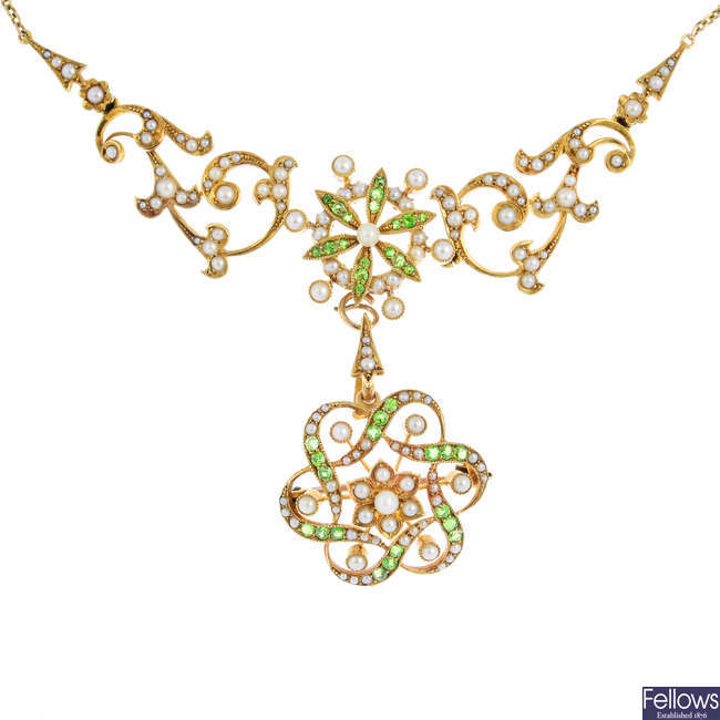 An Edwardian 15ct gold demantoid garnet and split pearl necklace, with detachable brooch/pendant.