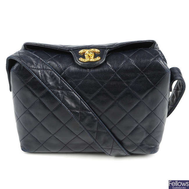 CHANEL - a vintage navy blue quilted handbag.