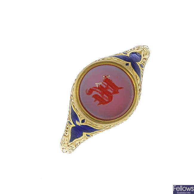 An early 20th century 18ct gold sardonyx and enamel signet ring.