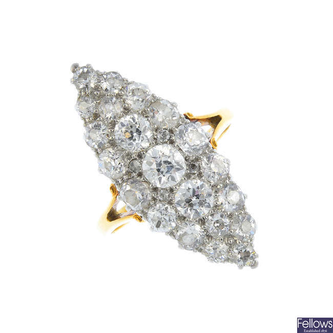 An early 20th century platinum and gold diamond cluster ring.