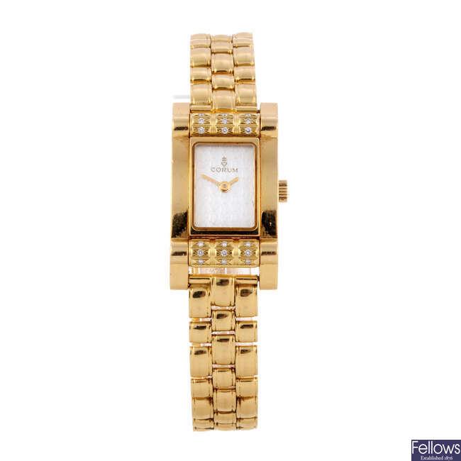 CORUM - a lady's 18ct yellow gold Tabogan bracelet watch.