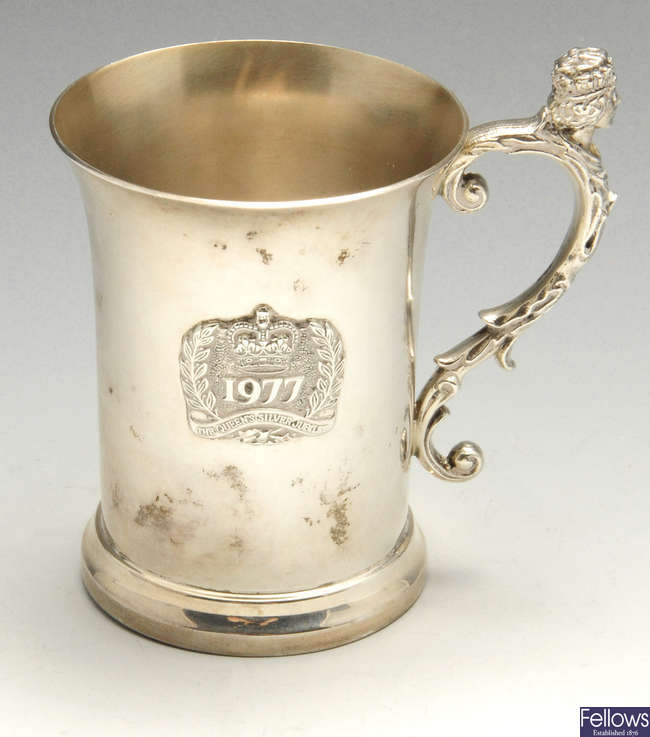 A modern silver mug commemorating The Queen's Silver Jubilee.