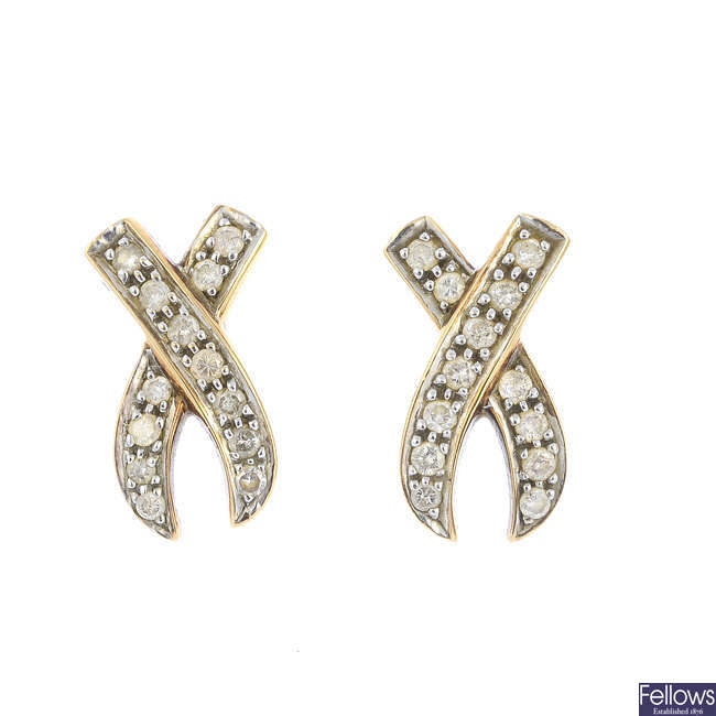 A pair of 9ct gold diamond earrings.