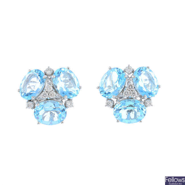 A pair of topaz and diamond earrings.
