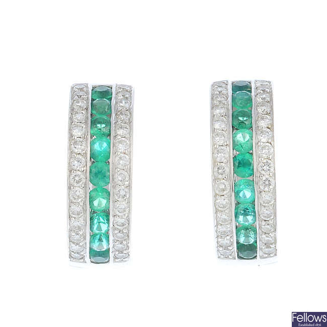 A pair of 18ct gold emerald and diamond hoop earrings.