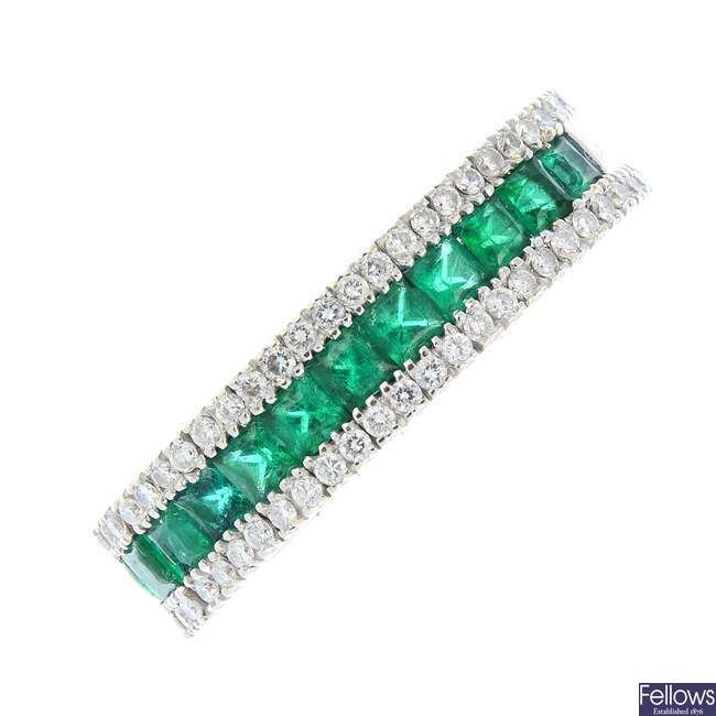 An 18ct gold emerald and diamond flexible ring.