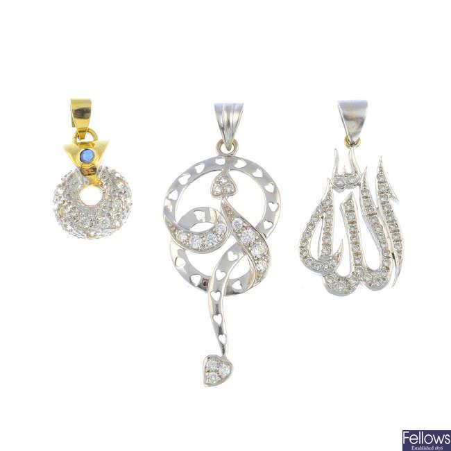 Three diamond and gem-set pendants.