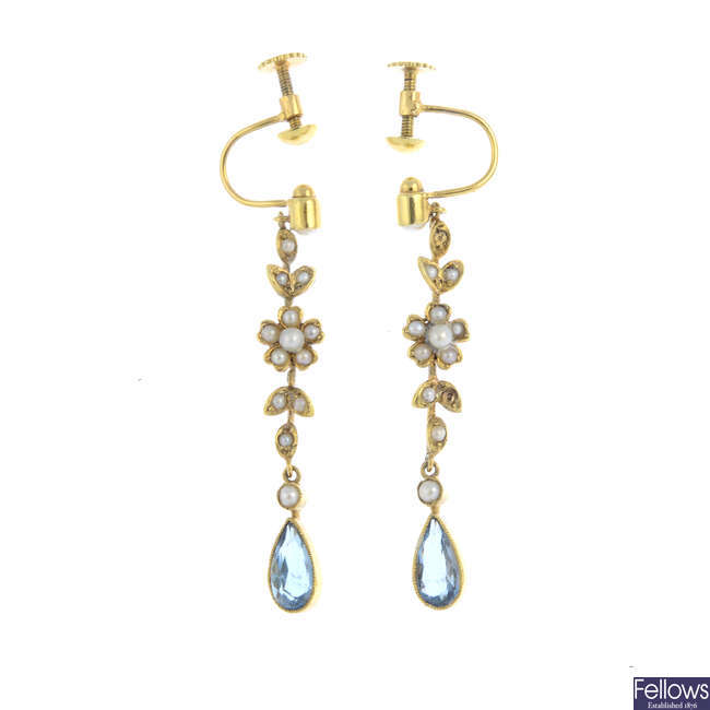 A pair of early 20th century gold aquamarine and split pearl earrings.