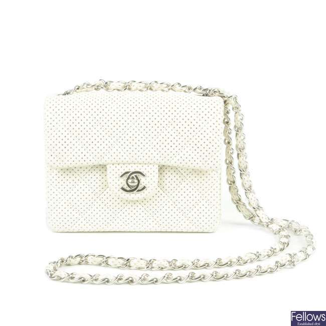CHANEL - a Mini Perforated Single Flap handbag.