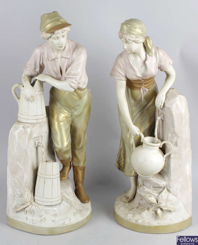 A pair of Royal Dux figurines.