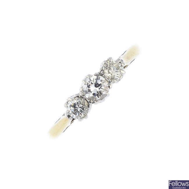 An 18ct gold and palladium diamond three-stone ring.