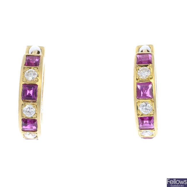 A pair of diamond and ruby hoop earrings.