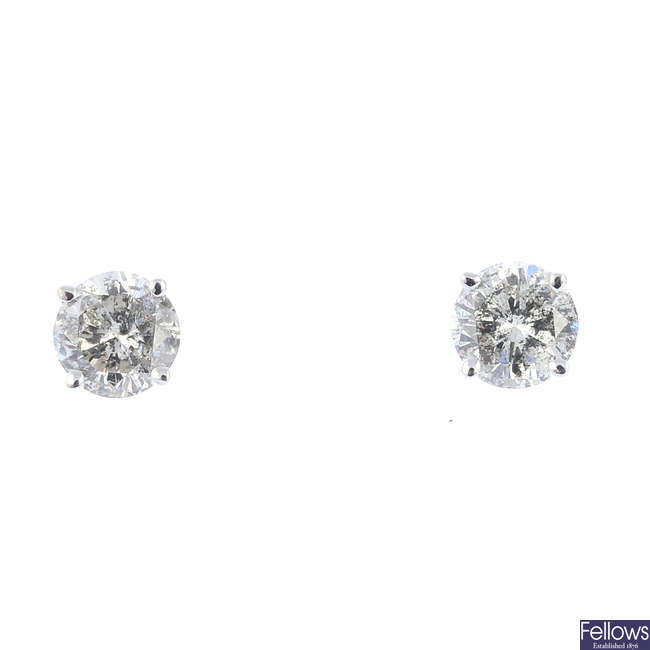 A pair of 14ct gold brilliant-cut diamond stud earrings.