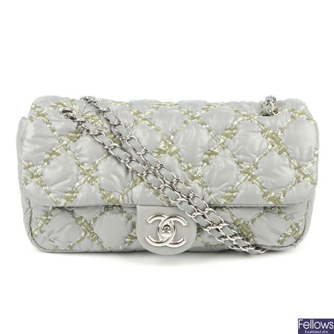 CHANEL - a Quilted Tweed Stitch Medium Bubble Flap handbag.