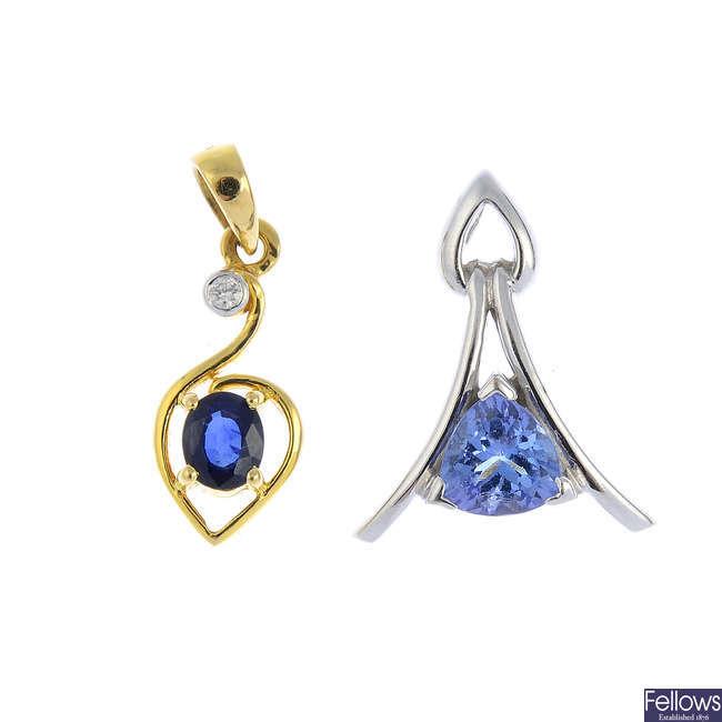 Two gold gem-set pendants.