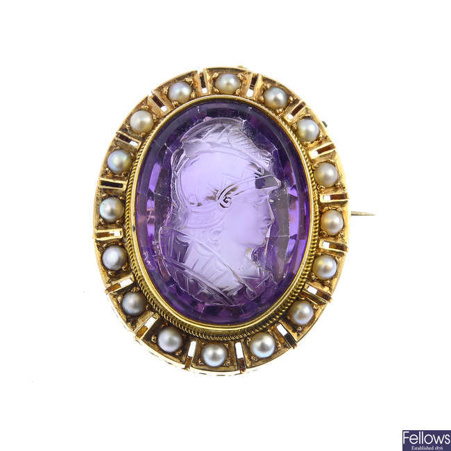 A mid Victorian gold amethyst cameo and split pearl brooch.