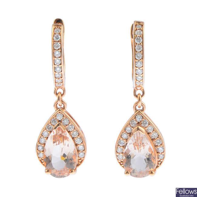 A pair of morganite and diamond earrings.