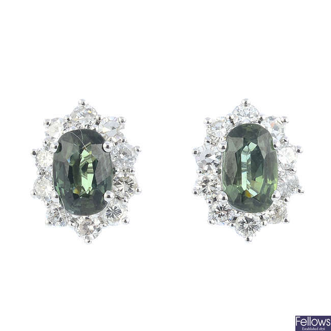 A pair of green sapphire and diamond cluster earrings.