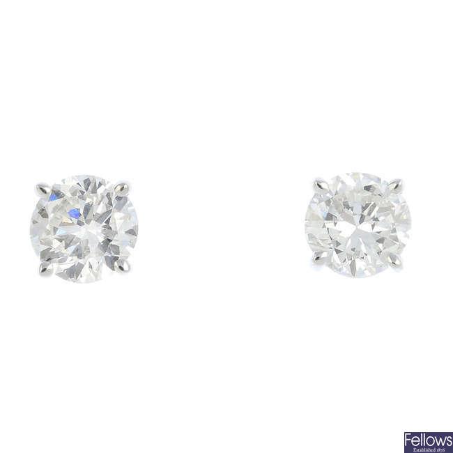A pair of 18ct gold circular-cut diamond stud earrings.