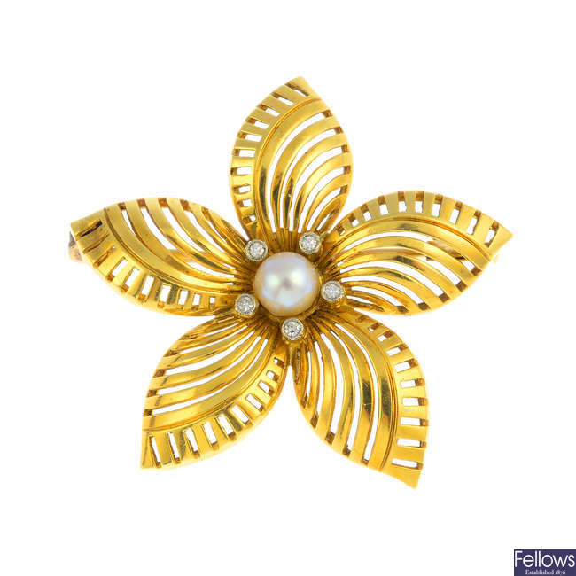 A cultured pearl and diamond flower brooch.