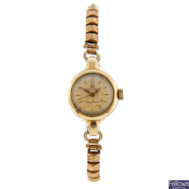 OMEGA - a lady's gold plated Seamaster Ladymatic bracelet watch.