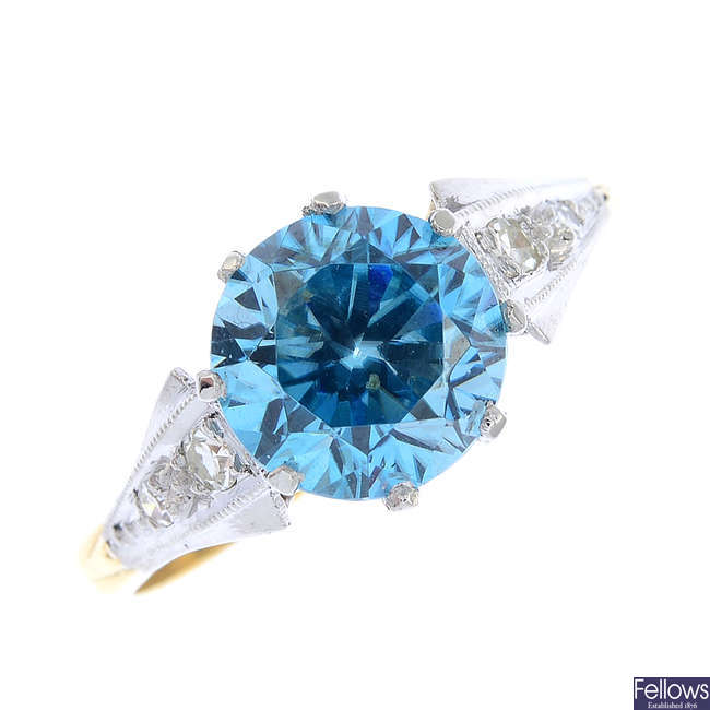 A zircon and diamond dress ring.