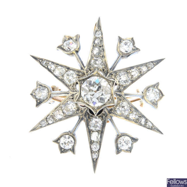 A late Victorian silver and gold diamond star brooch.