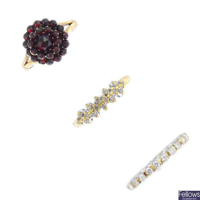Five diamond and gem-set rings.