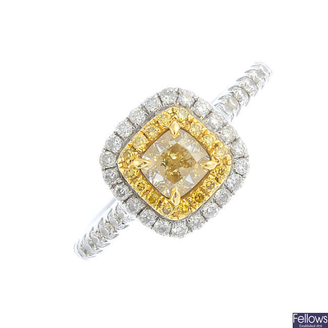An 18ct gold 'yellow' diamond and diamond cluster ring.