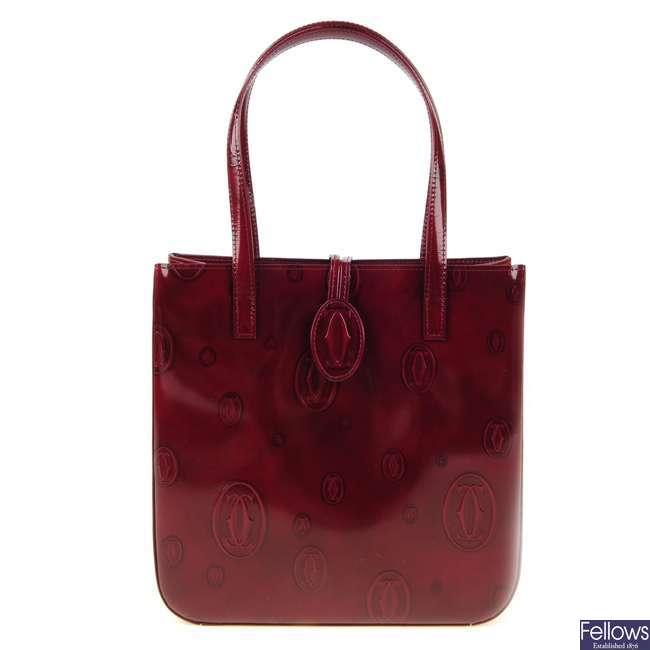 CARTIER - a Happy Birthday Bordeaux handbag.