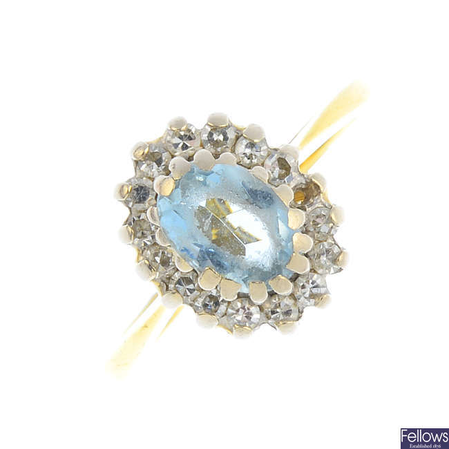 An 18ct gold aquamarine and diamond cluster ring. AF.