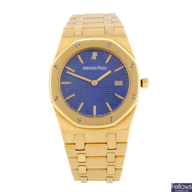 AUDEMARS PIGUET - a mid-size 18ct yellow gold Royal Oak bracelet watch.