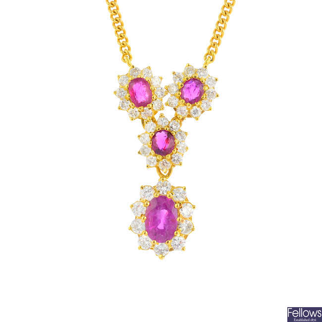 An 18ct gold ruby and diamond floral cluster necklace.