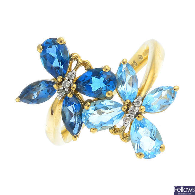 A 9ct gold topaz and diamond butterfly ring.