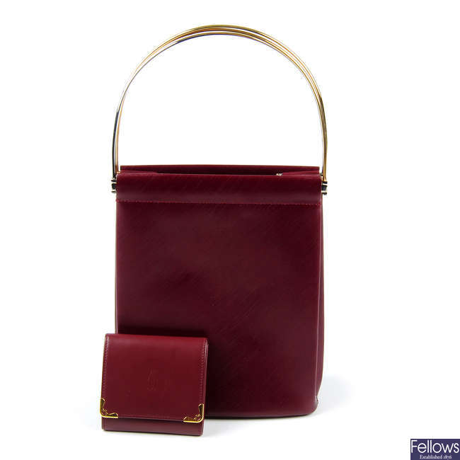 CARTIER - a Bordeaux Trinity handbag with coin purse.