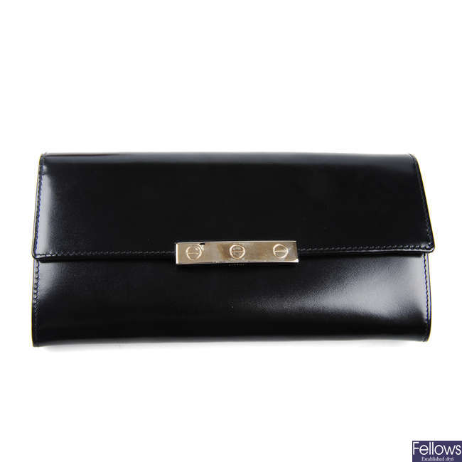 CARTIER - a black Love International leather wallet.