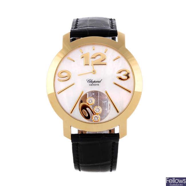CHOPARD - a lady's 18ct yellow gold Happy Diamonds wrist watch.