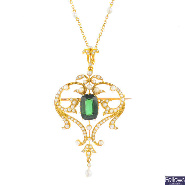 An Edwardian 15ct gold tourmaline and split pearl pendant, with 10ct seed pearl chain.