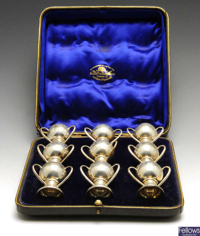A cased set of nine Edwardian silver miniature 'tyg' shot cups.