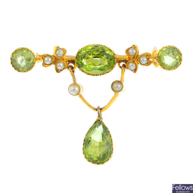 An early 20th century gold peridot and split pearl brooch.