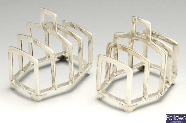A pair of modern silver toast racks.