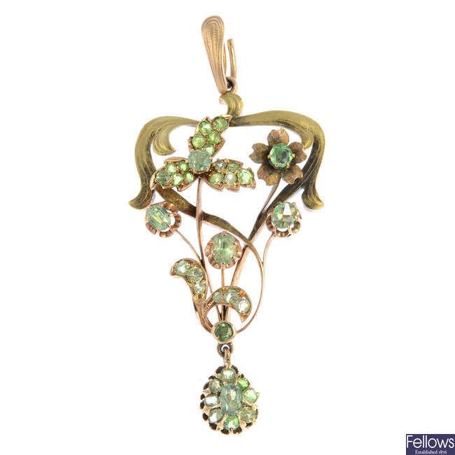 An early 20th century gold demantoid garnet pendant.