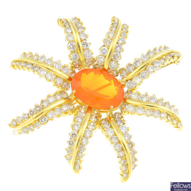 A fire opal and diamond floral brooch.